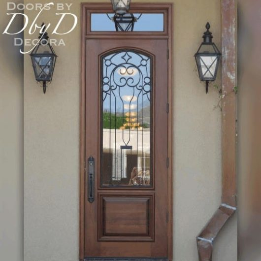 This commercial door features a custom wrought iron grill.