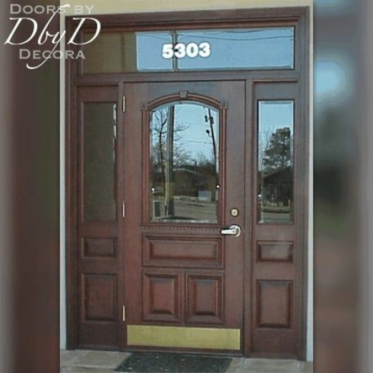 Commercial entrance featuring door, two side lites, and transom all with beveled glass.