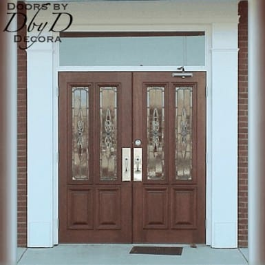 Double commercial doors with custom leaded glass.