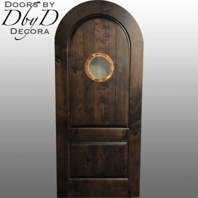 A working porthole can be found in the center of this beautiful door.