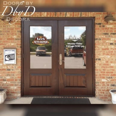 A pair of double doors shown on a local business.