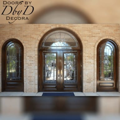 An exterior view of this commercial double doors and radius transom.