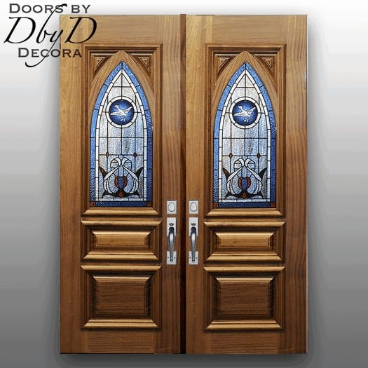 A pair of double church doors with custom panels and stained glass.