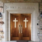 Applied crosses add to the beauty of these church doors.