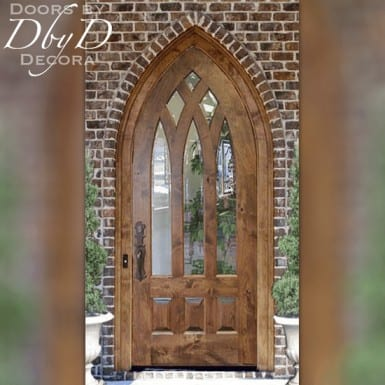 A beautiful example of a cathedral top door with beveled glass.