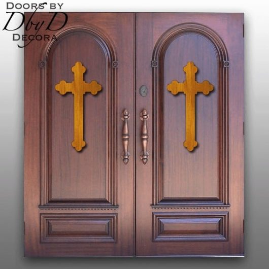A pair of double doors with an applied cross molding done in a different stain color.