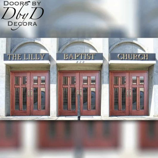 Three sets of double cross doors grace the front of this church.