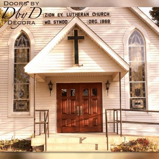 A close up look at the custom cross doors that we installed on this church.