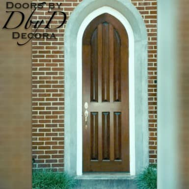 This is a beautiful and simple solid gothic arch church door.
