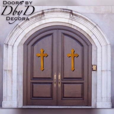 A beautiful pair of solid mahogany common segment top doors with carved crosses applied to the front.