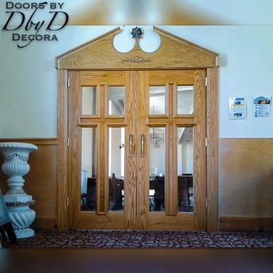 "Our standard ""cross doors"" featuring beveled glass."