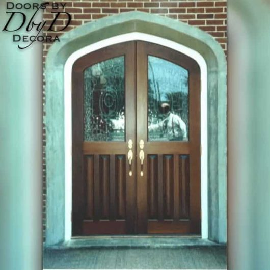 A pair of common gothic arch church doors custom designed and built by Doors by Decor.