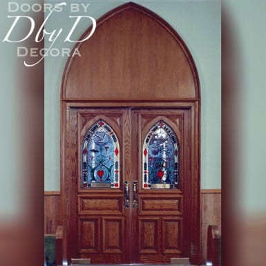 This pair of gothic arch doors mirror the beautiful gothic arch solid wood transom found above them.