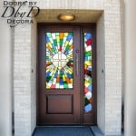 This is a beautiful example of how color can be used to accentuate the artful design of a door.