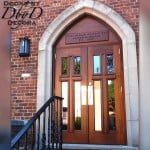 "These ""cross doors"" were custom built to fit inside this beautiful stone gothic arch."