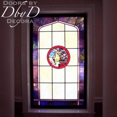 Church stained glass window with a hand painted medallion in the center.