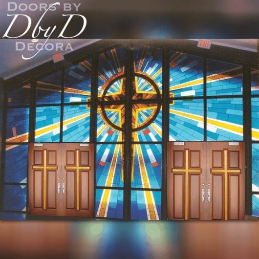 A very large church stained glass window surrounds these doors also provided by Doors by Decora.