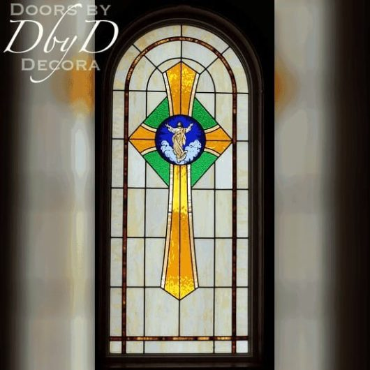 Church stained glass window with center hand painted medallion showing Christ.