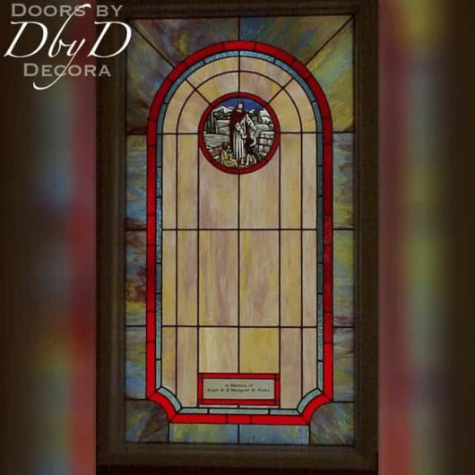 Church stained glass window with hand painted medallion and a dedication area.