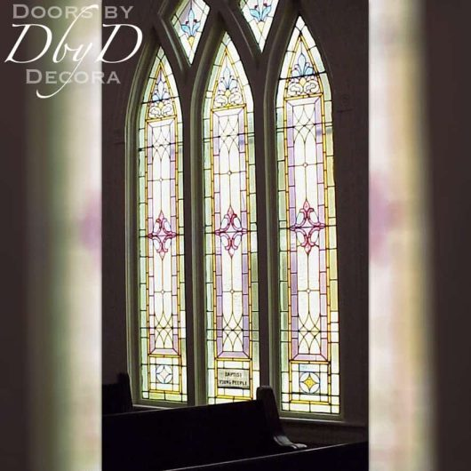 A beautiful cathedral set of church stained glass windows.