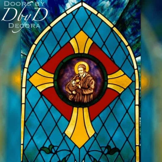 A close-up look at the hand painted medallion in this church stained glass window.