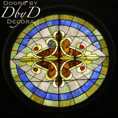 A rosette style church stained glass window.