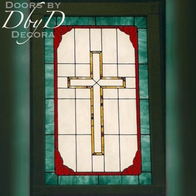 A church stained glass window depicting a cross.