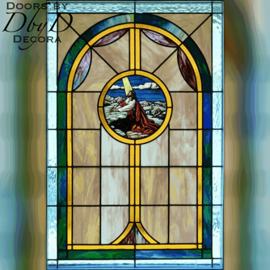 Church stained glass with a hand painted medallion depicting Christ.