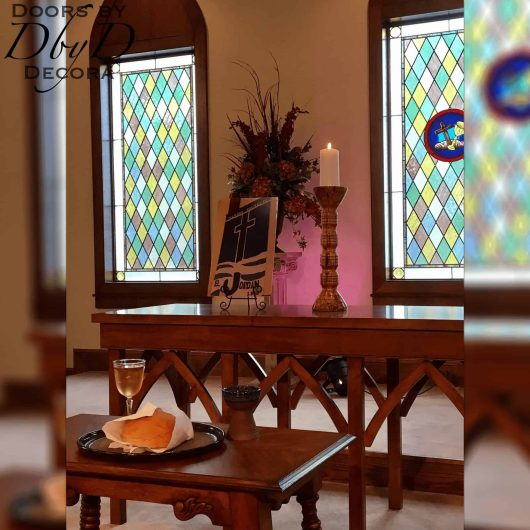 Old world style church stained glass with hand painted medallion.