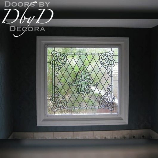 A large garden tub window featuring leaded and beveled glass.