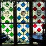 Beautiful stained glass window with several pieces of hand painted glass.