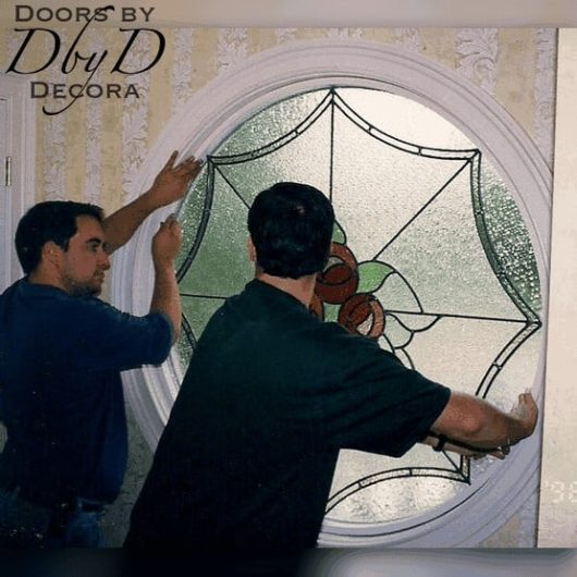 Current owners J.K. Jones and Bill Poole install a window many years ago.