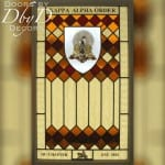 Custom stained glass with a hand painted medallion.