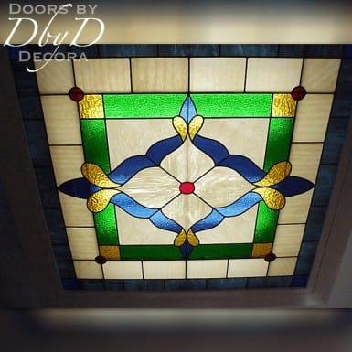 A piece of stained glass made to be a light cover.
