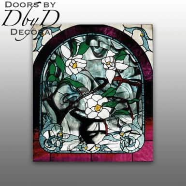 A large floral stained glass window.