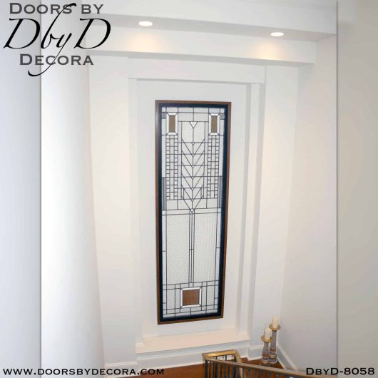 This stairway features a beautiful piece of hanging craftsman style glass custom built and designed by Doors by Decora.