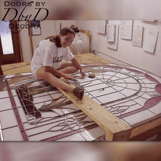 One our our stained glass artisans during the construction phase of a large stained glass window.