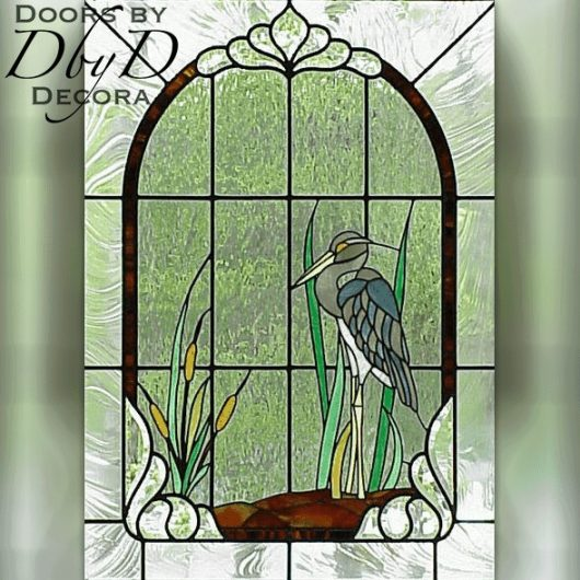 A blue heron is shown in this stained glass window.