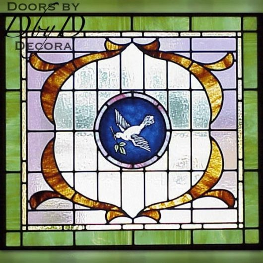 A dove shown in a piece of stained glass.