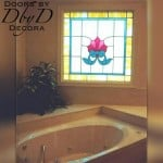 Stained glass window shown above a garden tub.
