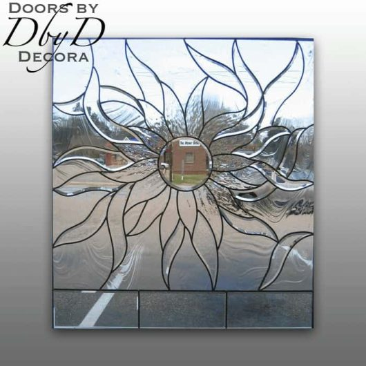 A sunburst leaded glass window.