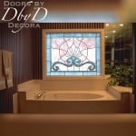 A large bathroom stained glass window.