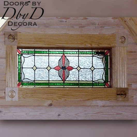Small rectangular piece of stained glass.