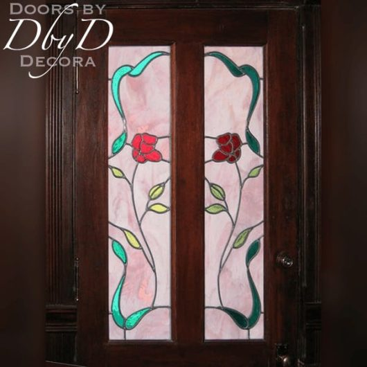 Custom stained glass windows in a vintage door.