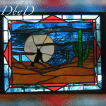 This piece of stained glass has a southwest flare to it with the cactus and howling wolf.