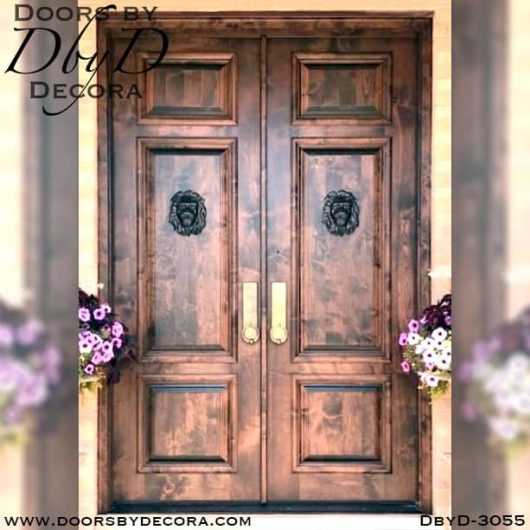 rustic doors with lion heads