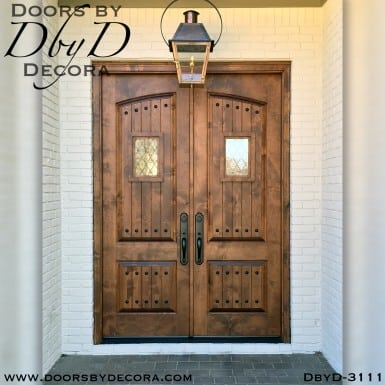 rustic arched panel double doors