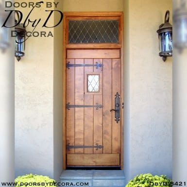 rustic plank door with speakeasy