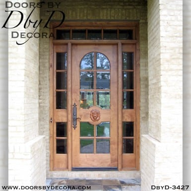 rustic lion head door with transom