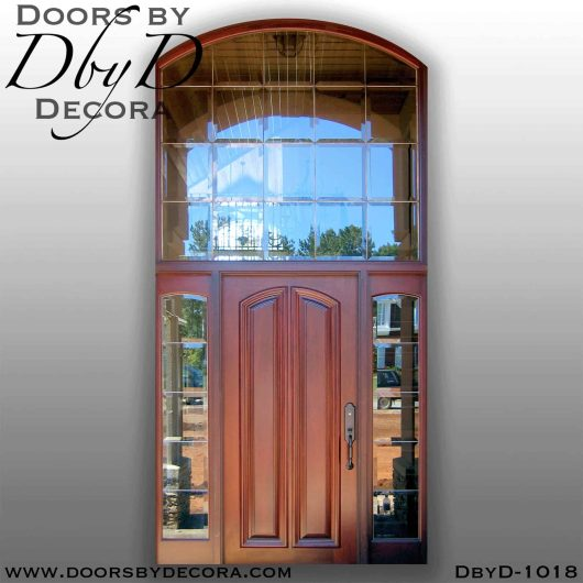 solid door and leaded glass transom